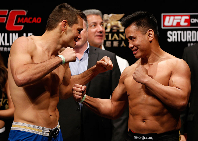 MACAU, MACAU - NOVEMBER 09:  (L-R) Opponents Rich Franklin and Cung Le face off during the UFC Macau weigh in at Cotai Arena on November 9, 2012 in Macau, Macau.  (Photo by Josh Hedges/Zuffa LLC/Zuffa LLC via Getty Images)