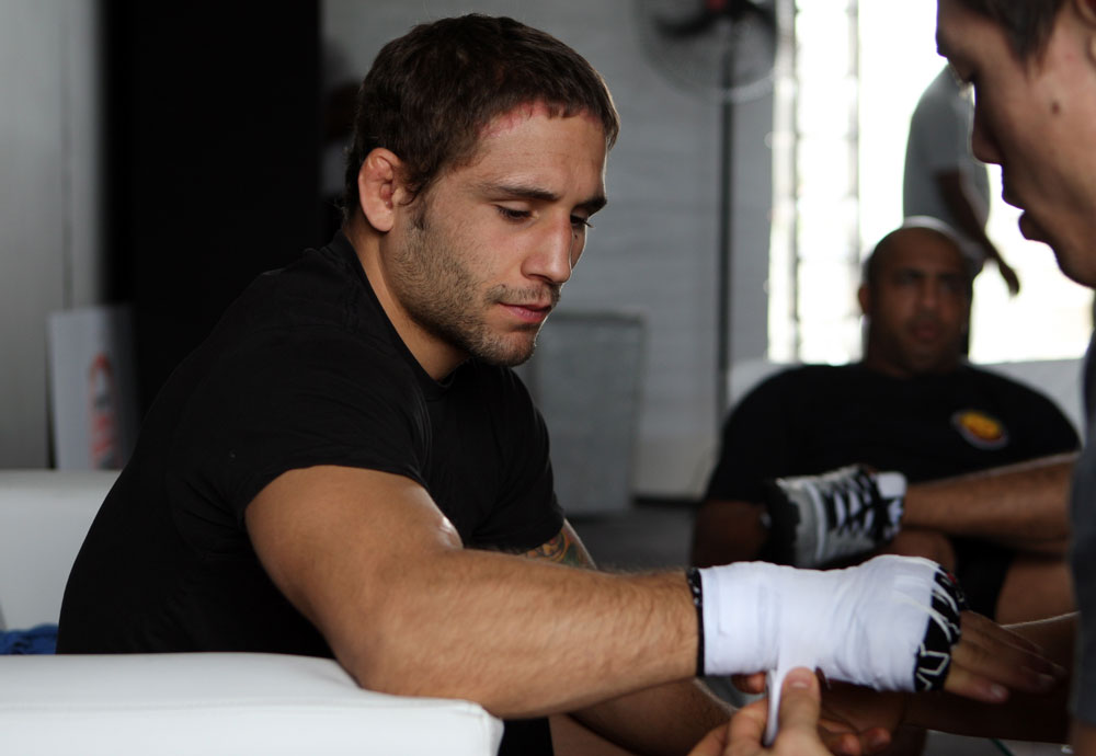 RIO DE JANEIRO, BRAZIL - JANUARY 11:  Chad Mendes has his hands wrapped before the UFC 142 Open Workouts at Barra de Tijuca Beach on January 11, 2012 in Rio de Janeiro, Brazil.  (Photo by Josh Hedges/Zuffa LLC/Zuffa LLC via Getty Images)