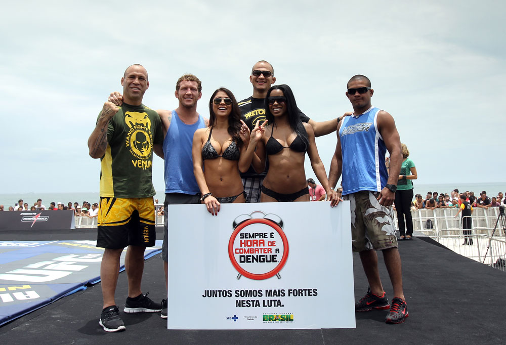 RIO DE JANEIRO, BRAZIL - JANUARY 11:  (L-R) Wanderlei Silva, Gray Maynard, Arianny Celeste, Junior dos Santos, Chandella Powell, and Diego Brandao pose for a photo during the UFC 142 Open Workouts at Barra de Tijuca Beach on January 11, 2012 in Rio de Janeiro, Brazil.  (Photo by Josh Hedges/Zuffa LLC/Zuffa LLC via Getty Images)