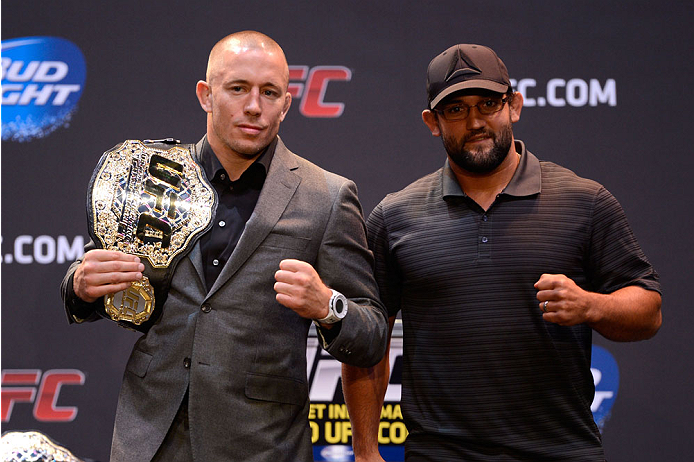 LOS ANGELES, CA - JULY 30:  UFC welterweight champion Georges St-Pierre (L) and upcoming opponent Johny Hendricks pose for the media during the UFC World Tour 2013 press conference at Club Nokia at L.A. Live on July 30, 2013 in Los Angeles, California. Georges St-Pierre will defend the UFC welterweight championship against Johny Hendricks November 16th at UFC 167 in Las Vegas. (Photo by Jeff Bottari/Zuffa LLC/Zuffa LLC via Getty Images)