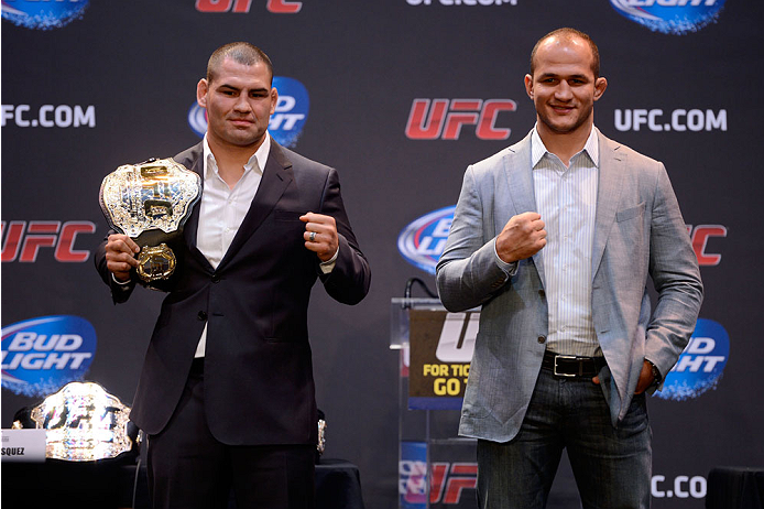 LOS ANGELES, CA - JULY 30:  UFC heavyweight champion Cain Valasquez (L) and upcoming opponent Junior Dos Santos (R) square off during the UFC World Tour 2013 press conference at Club Nokia at L.A. Live on July 30, 2013 in Los Angeles, California. Cain Velasquez will defend the UFC heavyweight championship against Junior Dos Santos October 19th at UFC 166 in Houston.  (Photo by Jeff Bottari/Zuffa LLC/Zuffa LLC via Getty Images)