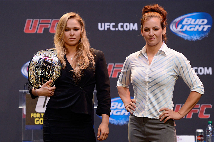 LOS ANGELES, CA - JULY 30:  UFC women's bantamweight champion Ronda Rousey (L) and Miesha Tate face off during the UFC World Tour 2013 at Club Nokia at L.A. Live on July 30, 2013 in Los Angeles, California. Ronda Rousey will defend the UFC women's bantamweight championship against Miesha Tate December 28th at UFC 168 in Las Vegas.  (Photo by Jeff Bottari/Zuffa LLC/Zuffa LLC via Getty Images)