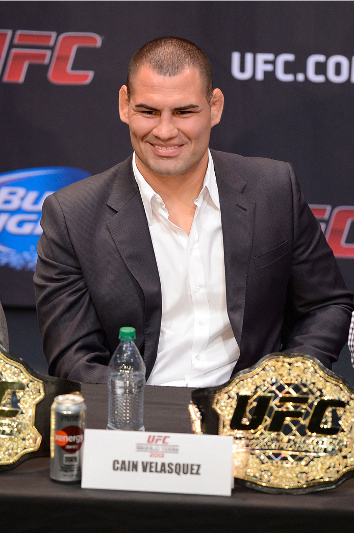 LOS ANGELES, CA - JULY 30:  UFC heavyweight champion Cain Valasquez interacts with the media during the UFC World Tour 2013 press conference at Club Nokia at L.A. Live on July 30, 2013 in Los Angeles, California.  (Photo by Jeff Bottari/Zuffa LLC/Zuffa LLC via Getty Images)