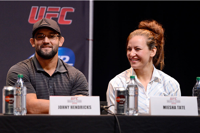 LOS ANGELES, CA - JULY 30:  (L-R) Johny Hendricks and Miesha Tate interact with the media during the UFC World Tour 2013 press conference at Club Nokia at L.A. Live on July 30, 2013 in Los Angeles, California.  (Photo by Jeff Bottari/Zuffa LLC/Zuffa LLC via Getty Images)