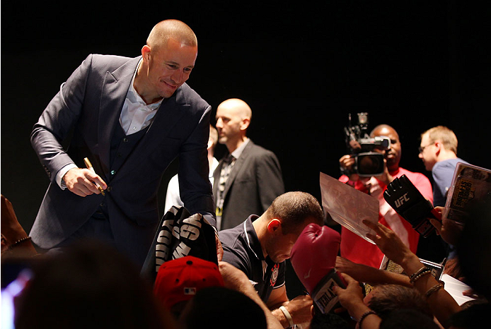 NEW YORK, NY - JULY 31:  UFC welterweight champion Georges St-Pierre interacts with fans during a press conference at the Beacon Theatre on July 31, 2013 in New York City.  (Photo by Mike Stobe/Zuffa LLC/Zuffa LLC via Getty Images)