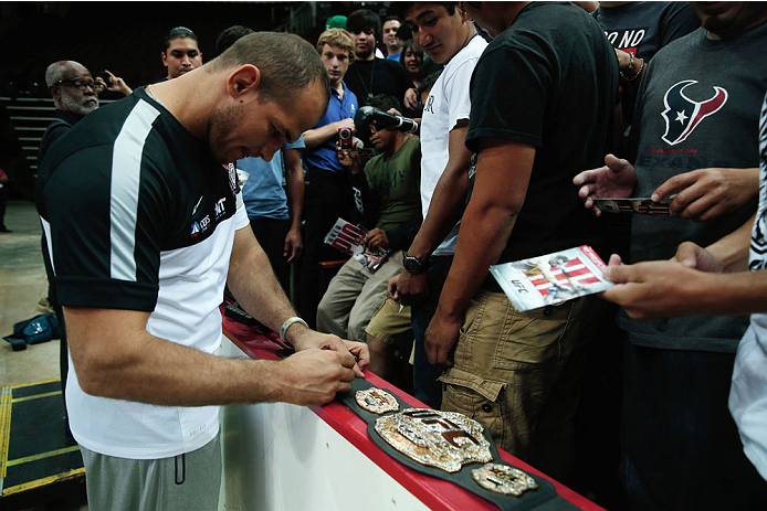 HOUSTON, TX - AUGUST 01:  UFC fighter Junior dos Santos of Brazil signs autographs fans during an open workout at the Toyota Center to promote his October 19, title fight with Cain Velasquez on August 1, 2013 in Houston, Texas.  (Photo by Scott Halleran/Zuffa LLC/Zuffa LLC via Getty Images)