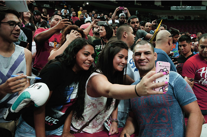 HOUSTON, TX - AUGUST 01:  UFC fighter Cain Velasquez poses for media and fans during an open workout at the Toyota Center to promote his October 19, title fight with Junior dos Santos on August 1, 2013 in Houston, Texas.  (Photo by Scott Halleran/Zuffa LLC/Zuffa LLC via Getty Images)