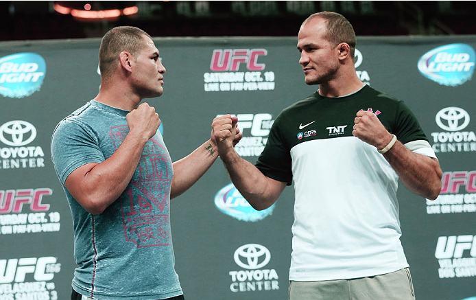 HOUSTON, TX - AUGUST 01:  UFC fighters Cain Velasquez (L) and Junior dos Santos of Brazil (R) pose for media and fans during an open workout at the Toyota Center to promote their October 19, title fight on August 1, 2013 in Houston, Texas.  (Photo by Scott Halleran/Zuffa LLC/Zuffa LLC via Getty Images)