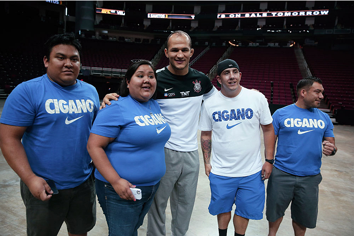 HOUSTON, TX - AUGUST 01:  UFC fighter Junior dos Santos of Brazil poses with fans during an open workout at the Toyota Center to promote his October 19, title fight with Cain Velasquez on August 1, 2013 in Houston, Texas.  (Photo by Scott Halleran/Zuffa LLC/Zuffa LLC via Getty Images)