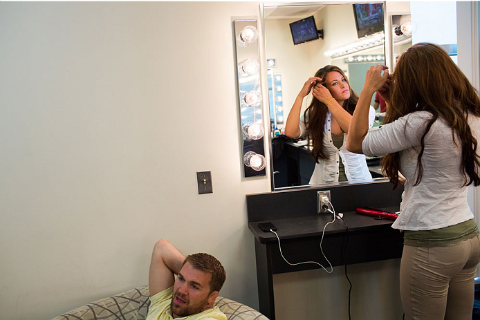 BRISTOL, CT - AUGUST 1: UFC bantamweight fighter Miesha Tate waits with her boyfriend Bryan Caraway, also a UFC fighter in the makeup room at ESPN's headquarters on August 1, 2013, in Bristol, Connecticut. Tate will battle bantamweight champion Ronda Rousey in December for the title. The two were interviewed on Sportscenter, by ESPN.com, by ESPN W, on the Dan Lebatard Show and on ESPN Deportes. (Photo by Christopher Capozziello/Zuffa LLC via Getty Images)