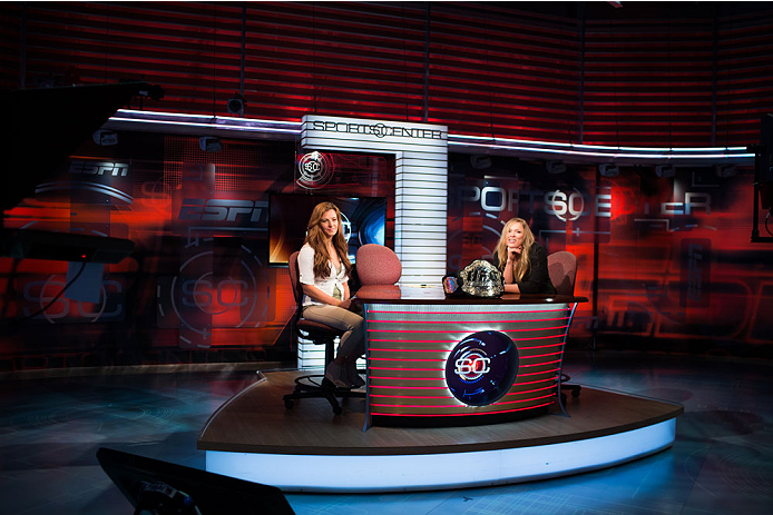 BRISTOL, CT - AUGUST 1: UFC bantamweight champion Ronda Rousey (R) and Miesha Tate are interviewed on Sportscenter at ESPN's headquarters on August 1, 2013 in Bristol, Connecticut. The two will fight in December in a title bout. They were interviewed on Sportscenter, by ESPN.com, by ESPN W, on the Dan Lebatard Show, and on ESPN Deportes. (Photo by Christopher Capozziello/Zuffa LLC via Getty Images)