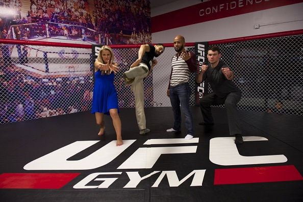 LAS VEGAS, NEVADA - JANUARY 28:  From L-R - Paige VanZant, Carlos Condit, Demetrious Johnson and Forrest Griffin do their best super hero pose at the UFC Gym in Green Valley. (Photo by Brandon Magnus/Zuffa LLC/Zuffa LLC)