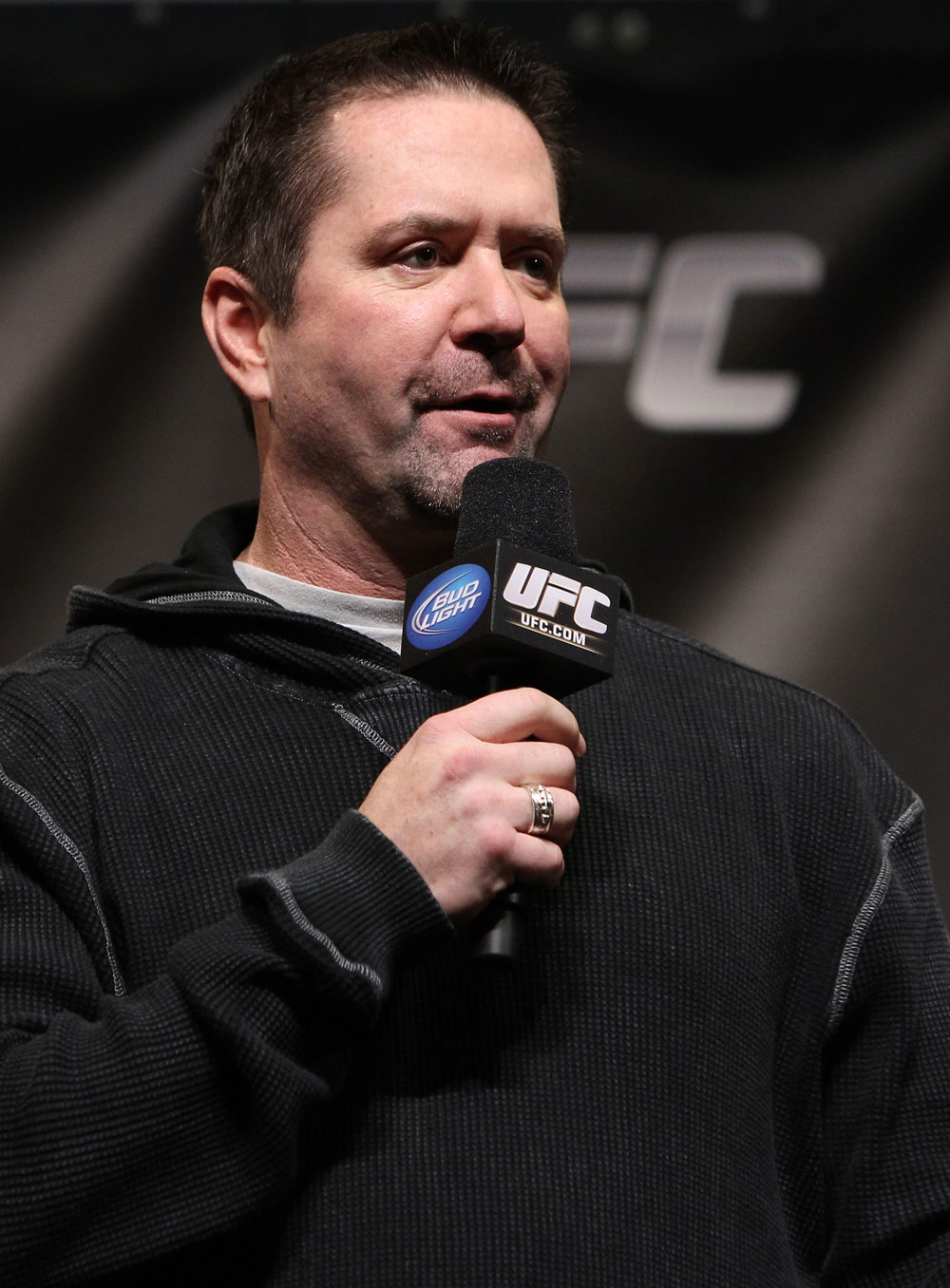 CHICAGO, IL - JANUARY 27:  UFC commentator Mike Goldberg interacts with fans during a Q&A session before the UFC on FOX official weigh in at the Chicago Theatre on January 27, 2012 in Chicago, Illinois.  (Photo by Josh Hedges/Zuffa LLC/Zuffa LLC via Getty Images) *** Local Caption *** Mike Goldberg