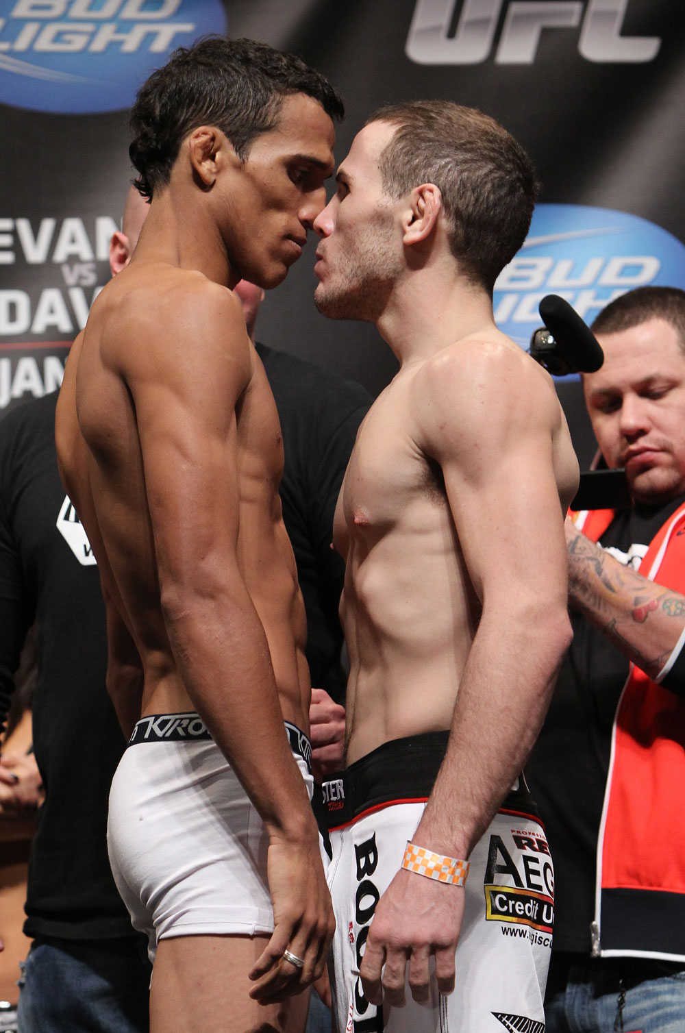 CHICAGO, IL - JANUARY 27:  (L-R) Featherweight opponents Charles Oliveira and Eric Wisely face off after weighing in during the UFC on FOX official weigh in at the Chicago Theatre on January 27, 2012 in Chicago, Illinois.  (Photo by Josh Hedges/Zuffa LLC/Zuffa LLC via Getty Images) *** Local Caption *** Charles Oliveira; Eric Wisely