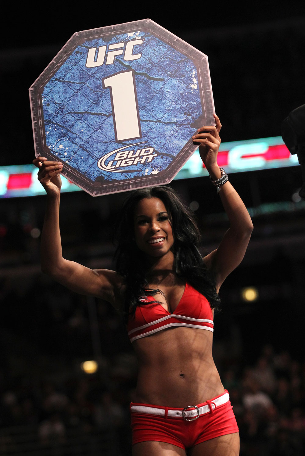 CHICAGO, IL - JANUARY 28:  UFC Octagon Girl Chandella Powell introduces round 1 before the Johnson vs Roller bout during the UFC on FOX event at United Center on January 28, 2012 in Chicago, Illinois.  (Photo by Nick Laham/Zuffa LLC/Zuffa LLC via Getty Images) *** Local Caption *** Chandella Powell