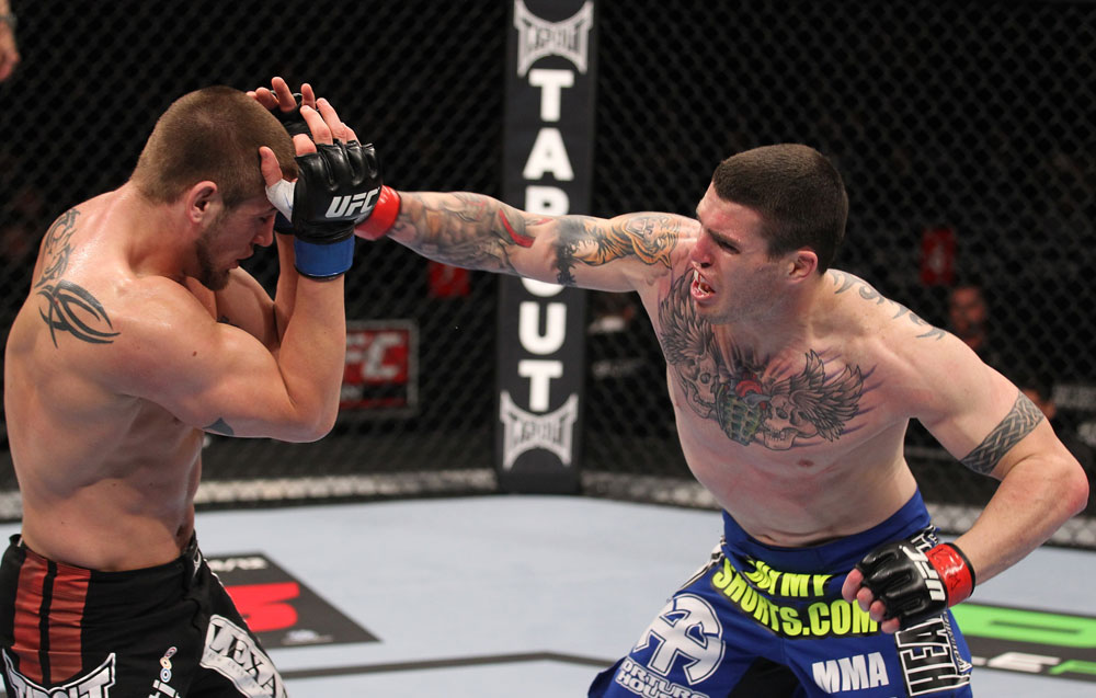 CHICAGO, IL - JANUARY 28:  (R-L) Chris Camozzi punches Dustin Jacoby during the UFC on FOX event at United Center on January 28, 2012 in Chicago, Illinois.  (Photo by Nick Laham/Zuffa LLC/Zuffa LLC via Getty Images) *** Local Caption *** Chris Camozzi; Dustin Jacoby