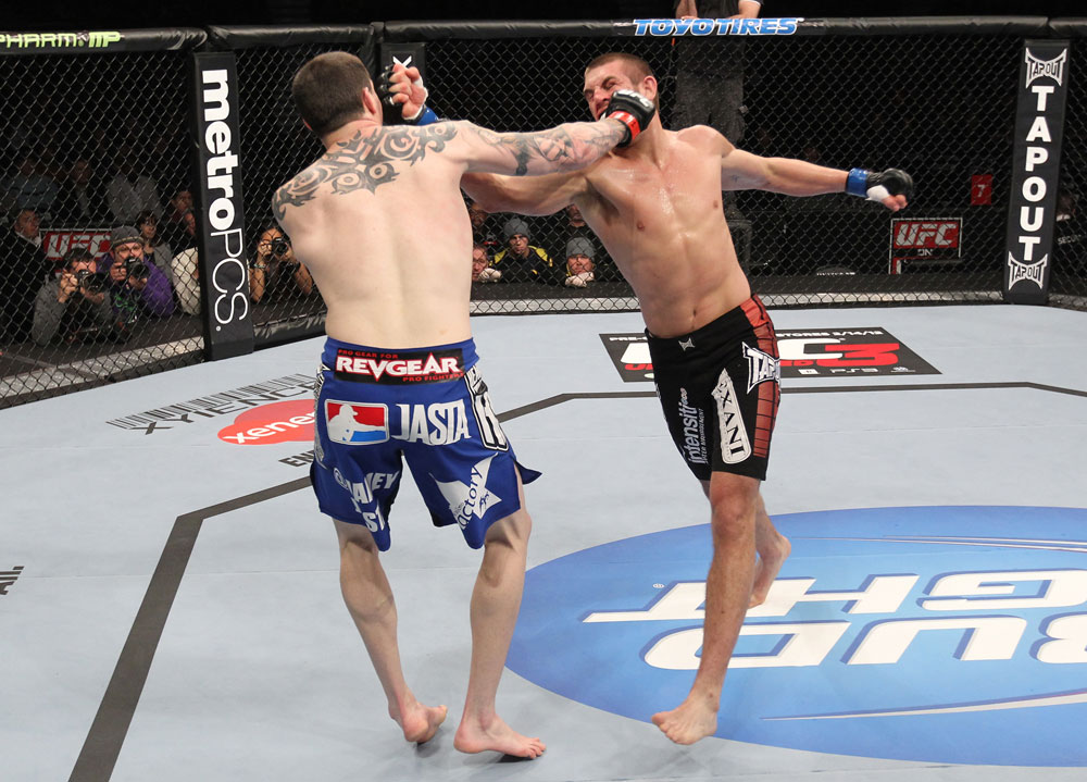 CHICAGO, IL - JANUARY 28:  (R-L) Dustin Jacoby and Chris Camozzi trade punches during the UFC on FOX event at United Center on January 28, 2012 in Chicago, Illinois.  (Photo by Nick Laham/Zuffa LLC/Zuffa LLC via Getty Images) *** Local Caption *** Chris Camozzi; Dustin Jacoby
