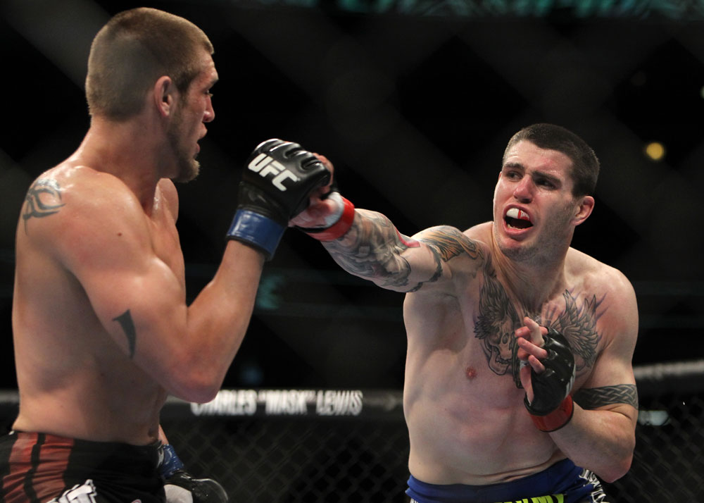 CHICAGO, IL - JANUARY 28:  (R-L) Chris Camozzi punches Dustin Jacoby during the UFC on FOX event at United Center on January 28, 2012 in Chicago, Illinois.  (Photo by Josh Hedges/Zuffa LLC/Zuffa LLC via Getty Images) *** Local Caption *** Chris Camozzi; Dustin Jacoby
