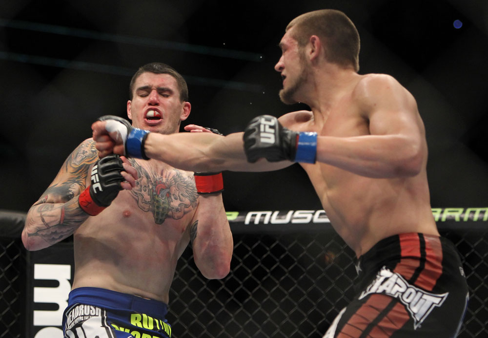 CHICAGO, IL - JANUARY 28:  (R-L) Dustin Jacoby punches Chris Camozzi during the UFC on FOX event at United Center on January 28, 2012 in Chicago, Illinois.  (Photo by Josh Hedges/Zuffa LLC/Zuffa LLC via Getty Images) *** Local Caption *** Chris Camozzi; Dustin Jacoby