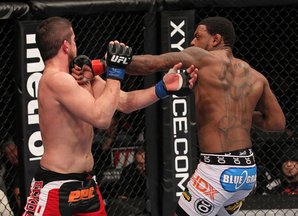 CHICAGO, IL - JANUARY 28:  (R-L) Michael Johnson punches Shane Roller during the UFC on FOX event at United Center on January 28, 2012 in Chicago, Illinois.  (Photo by Nick Laham/Zuffa LLC/Zuffa LLC via Getty Images) *** Local Caption *** Michael Johnson; Shane Roller