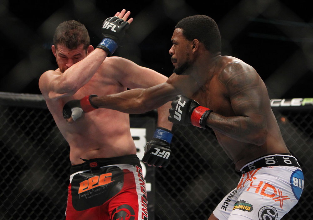 CHICAGO, IL - JANUARY 28:  (R-L) Michael Johnson punches Shane Roller during the UFC on FOX event at United Center on January 28, 2012 in Chicago, Illinois.  (Photo by Josh Hedges/Zuffa LLC/Zuffa LLC via Getty Images) *** Local Caption *** Michael Johnson; Shane Roller