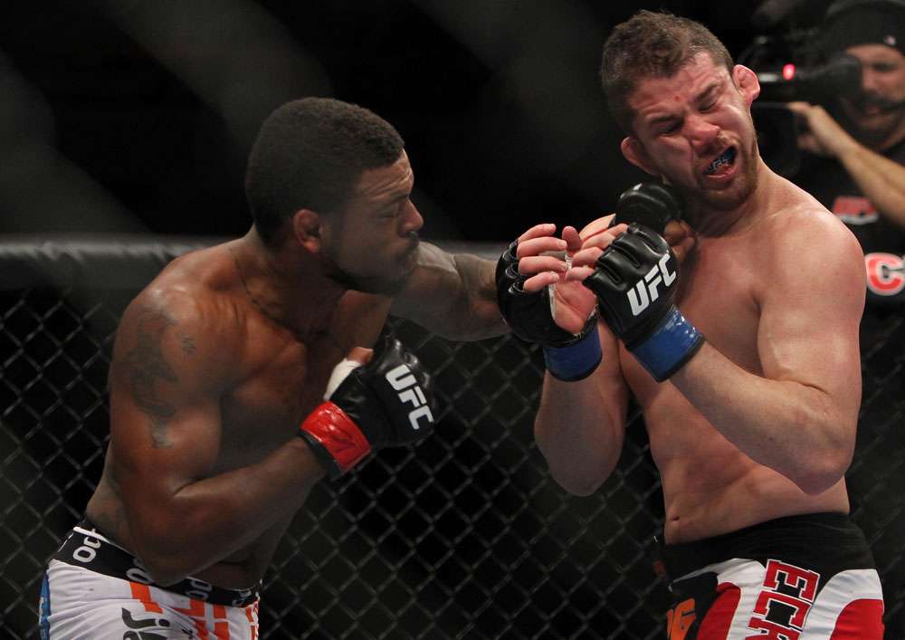 CHICAGO, IL - JANUARY 28:  (L-R) Michael Johnson punches Shane Roller during the UFC on FOX event at United Center on January 28, 2012 in Chicago, Illinois.  (Photo by Josh Hedges/Zuffa LLC/Zuffa LLC via Getty Images) *** Local Caption *** Michael Johnson; Shane Roller