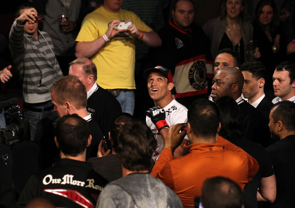 CHICAGO, IL - JANUARY 28:  Charles Oliveira enters the arena before his bout against Eric Wisely during the UFC on FOX event at United Center on January 28, 2012 in Chicago, Illinois.  (Photo by Nick Laham/Zuffa LLC/Zuffa LLC via Getty Images) *** Local Caption *** Charles Oliveira