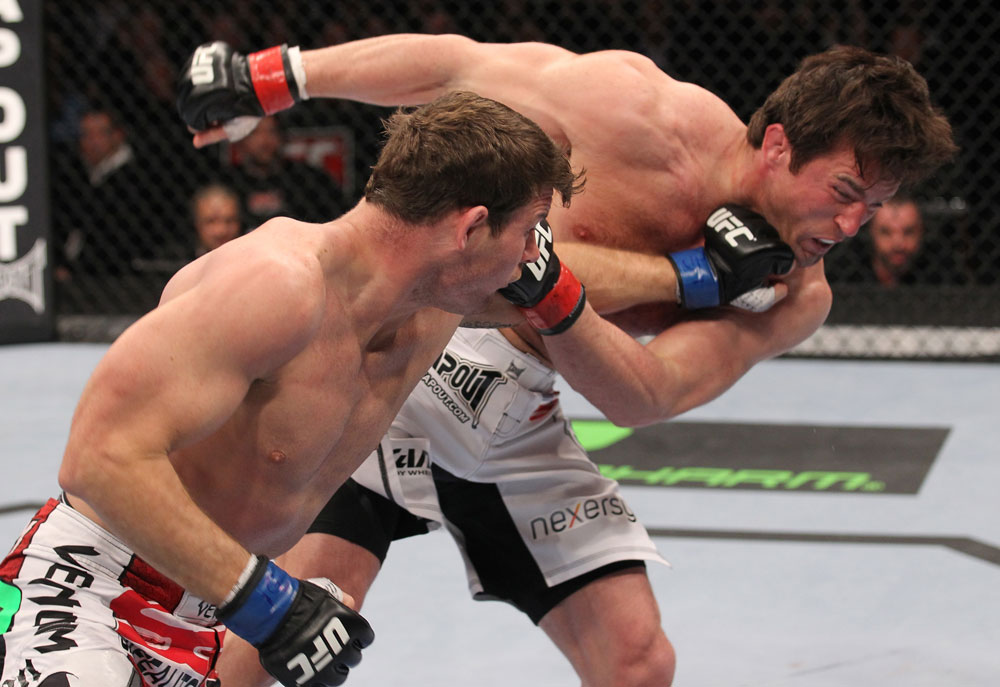 CHICAGO, IL - JANUARY 28:  (L-R) Michael Bisping punches Chael Sonnen during the UFC on FOX event at United Center on January 28, 2012 in Chicago, Illinois.  (Photo by Nick Laham/Zuffa LLC/Zuffa LLC via Getty Images) *** Local Caption *** Chael Sonnen; Michael Bisping
