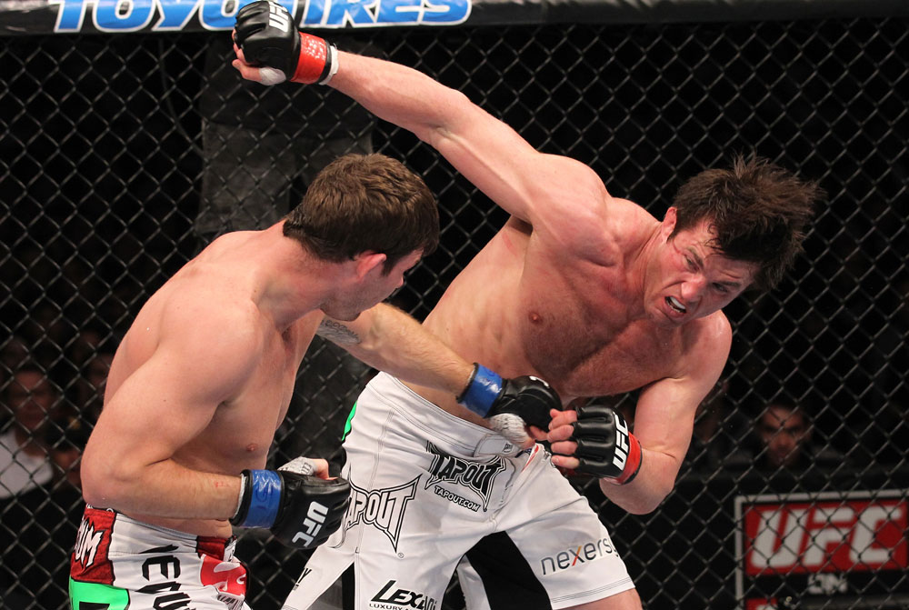 CHICAGO, IL - JANUARY 28:  (R-L) Chael Sonnen and Michael Bisping trade punches during the UFC on FOX event at United Center on January 28, 2012 in Chicago, Illinois.  (Photo by Nick Laham/Zuffa LLC/Zuffa LLC via Getty Images) *** Local Caption *** Chael Sonnen; Michael Bisping