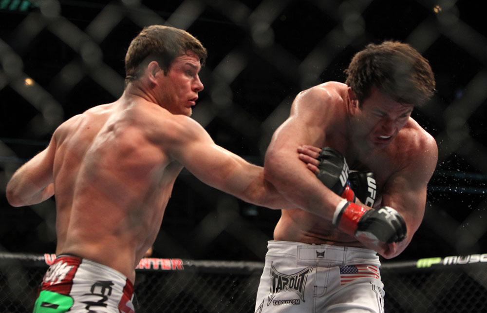 CHICAGO, IL - JANUARY 28:  (L-R) Michael Bisping punches Chael Sonnen during the UFC on FOX event at United Center on January 28, 2012 in Chicago, Illinois.  (Photo by Josh Hedges/Zuffa LLC/Zuffa LLC via Getty Images) *** Local Caption *** Chael Sonnen; Michael Bisping