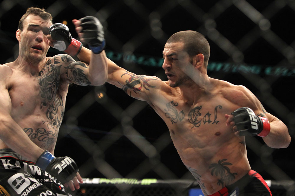 CHICAGO, IL - JANUARY 28:  (L-R) George Roop and Cub Swanson trade punches during the UFC on FOX event at United Center on January 28, 2012 in Chicago, Illinois.  (Photo by Josh Hedges/Zuffa LLC/Zuffa LLC via Getty Images) *** Local Caption *** Cub Swanson; George Roop