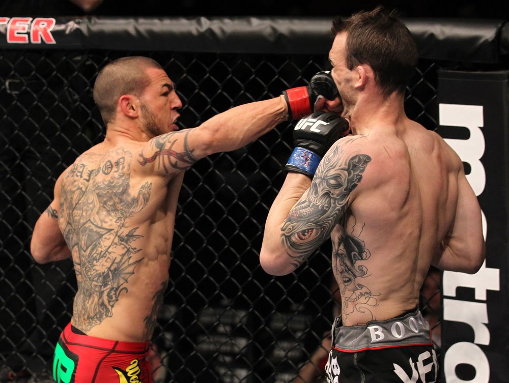 CHICAGO, IL - JANUARY 28:  (L-R) Cub Swanson punches George Roop during the UFC on FOX event at United Center on January 28, 2012 in Chicago, Illinois.  (Photo by Nick Laham/Zuffa LLC/Zuffa LLC via Getty Images) *** Local Caption *** George Roop; Cub Swanson