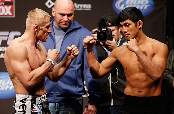 SEATTLE, WA - DECEMBER 07:  (L-R) Opponents Dennis Siver and Nam Phan face off during the official UFC on FOX weigh in on December 7, 2012 at Key Arena in Seattle, Washington.  (Photo by Josh Hedges/Zuffa LLC/Zuffa LLC via Getty Images)