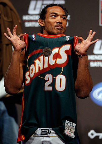 SEATTLE, WA - DECEMBER 07:  Benson Henderson stands on stage wearing a Gary Payton Seattle Sonics jersey during the official UFC on FOX weigh in on December 7, 2012 at Key Arena in Seattle, Washington.  (Photo by Josh Hedges/Zuffa LLC/Zuffa LLC via Getty Images)