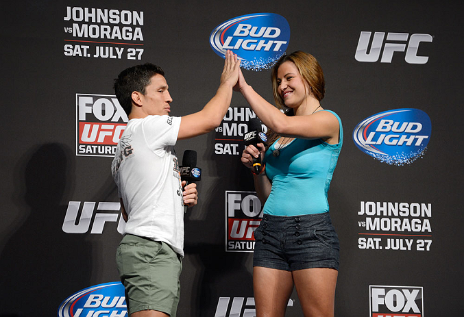 SEATTLE, WA - JULY 26:  Joseph Benevidez (L) and UFC women's bantamweight Miesha Tate interacts with fans during a Q&A session before the official UFC on FOX weigh-in at Key Arena on July 26, 2013 in Seattle, Washington.  (Photo by Jeff Bottari/Zuffa LLC/Zuffa LLC via Getty Images)