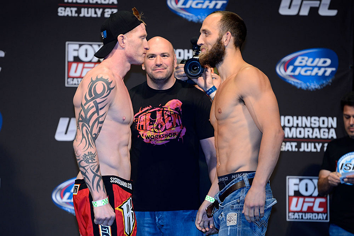 SEATTLE, WA - JULY 26:  Opponents Ed Herman (L) and Trevor Smith face off during the official UFC on FOX weigh-in at Key Arena on July 26, 2013 in Seattle, Washington.  (Photo by Jeff Bottari/Zuffa LLC/Zuffa LLC via Getty Images)
