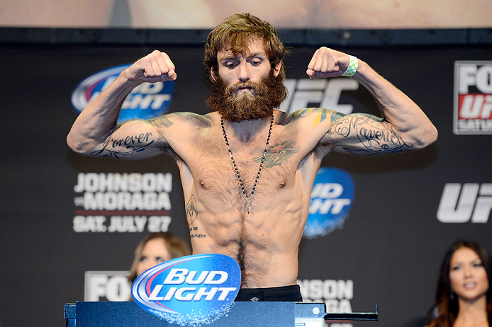 SEATTLE, WA - JULY 26:  Michael Chiesa weighs in during the official UFC on FOX weigh-in at Key Arena on July 26, 2013 in Seattle, Washington.  (Photo by Jeff Bottari/Zuffa LLC/Zuffa LLC via Getty Images)