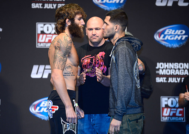 SEATTLE, WA - JULY 26:  Opponents Michael Chiesa (L) and Jorge Masvidal face off during the official UFC on FOX weigh-in at Key Arena on July 26, 2013 in Seattle, Washington.  (Photo by Jeff Bottari/Zuffa LLC/Zuffa LLC via Getty Images)