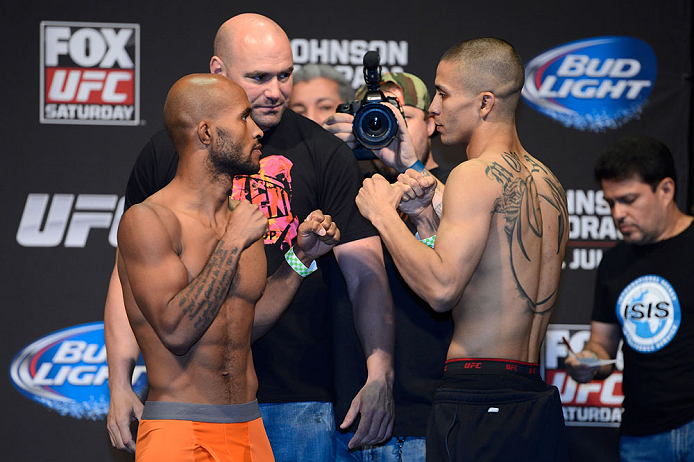 SEATTLE, WA - JULY 26:  Demetrious Johnson (L) and John Moraga face off during the official UFC on FOX weigh-in at Key Arena on July 26, 2013 in Seattle, Washington.  (Photo by Jeff Bottari/Zuffa LLC/Zuffa LLC via Getty Images)