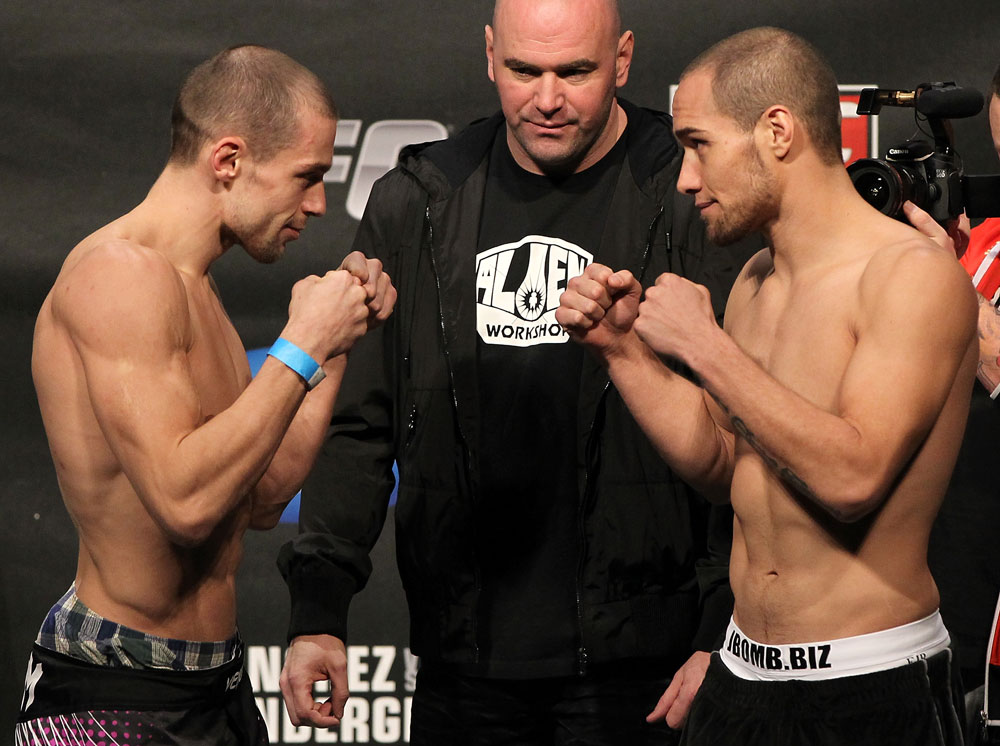 OMAHA, NE - FEBRUARY 14:  (L-R) Opponents Anton Kuivanen and Justin Salas face off after weighing in during the UFC on FUEL TV weigh in event at Omaha Civic Auditorium on February 14, 2012 in Omaha, Nebraska.  (Photo by Josh Hedges/Zuffa LLC/Zuffa LLC via Getty Images) *** Local Caption *** Anton Kuivanen; Justin Salas; Dana White