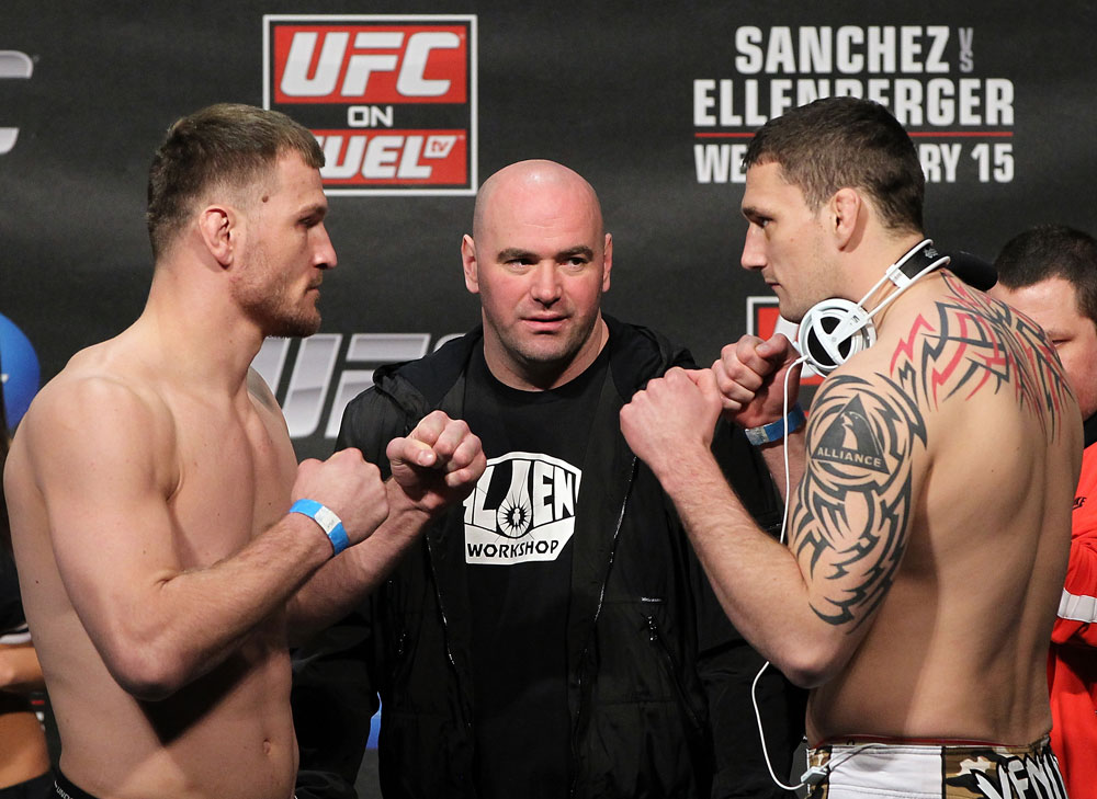 OMAHA, NE - FEBRUARY 14:  (L-R) Heavyweight opponents Stipe Miocic and Phil De Fries face off after weighing in during the UFC on FUEL TV weigh in event at Omaha Civic Auditorium on February 14, 2012 in Omaha, Nebraska.  (Photo by Josh Hedges/Zuffa LLC/Zuffa LLC via Getty Images) *** Local Caption *** Stipe Miocic; Phil De Fries; Dana White