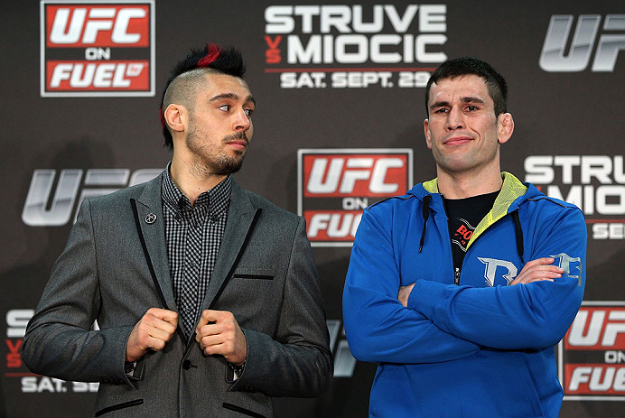 NOTTINGHAM, ENGLAND - SEPTEMBER 27:  (L-R) Opponents Dan Hardy and Amir Sadollah pose for photos during a UFC press conference at the Hilton Hotel on September 27, 2012 in Nottingham, England.  (Photo by Josh Hedges/Zuffa LLC/Zuffa LLC via Getty Images)