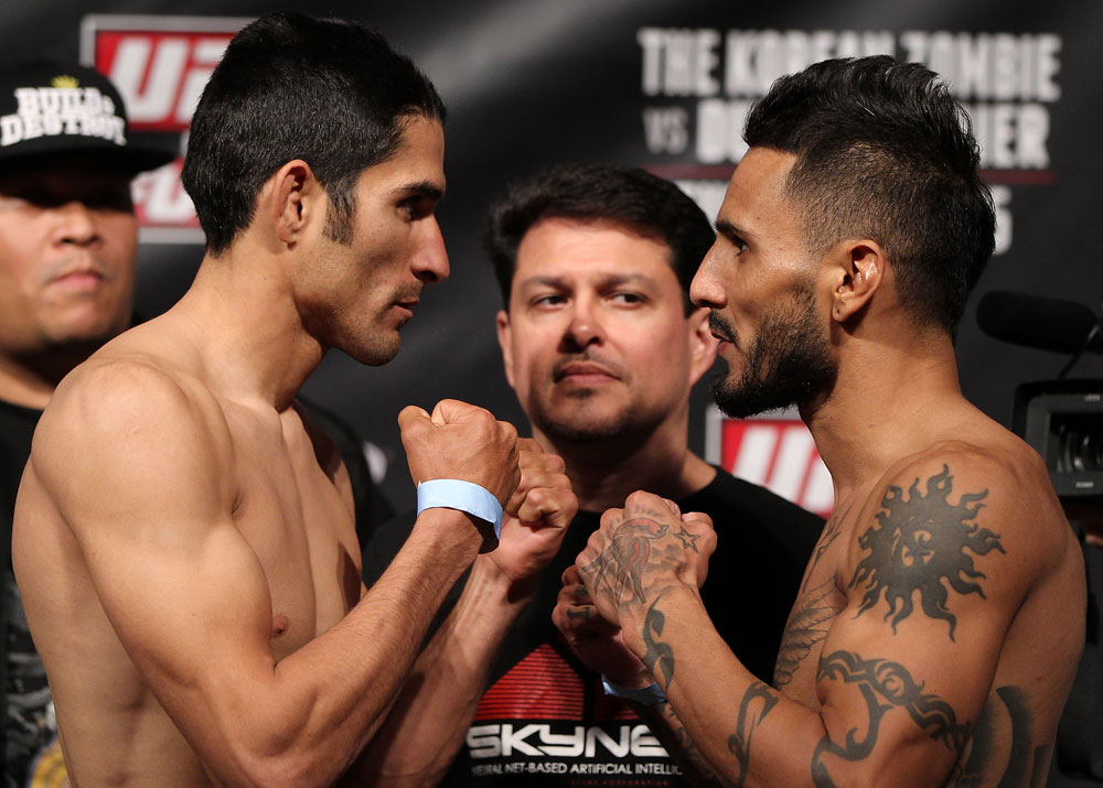 FAIRFAX, VA - MAY 14:  (L-R) Opponents Alex Soto and Francisco Rivera face off after weighing in during the UFC on Fuel TV official weigh in at Patriot Center on May 14, 2012 in Fairfax, Virginia.  (Photo by Josh Hedges/Zuffa LLC/Zuffa LLC via Getty Images)