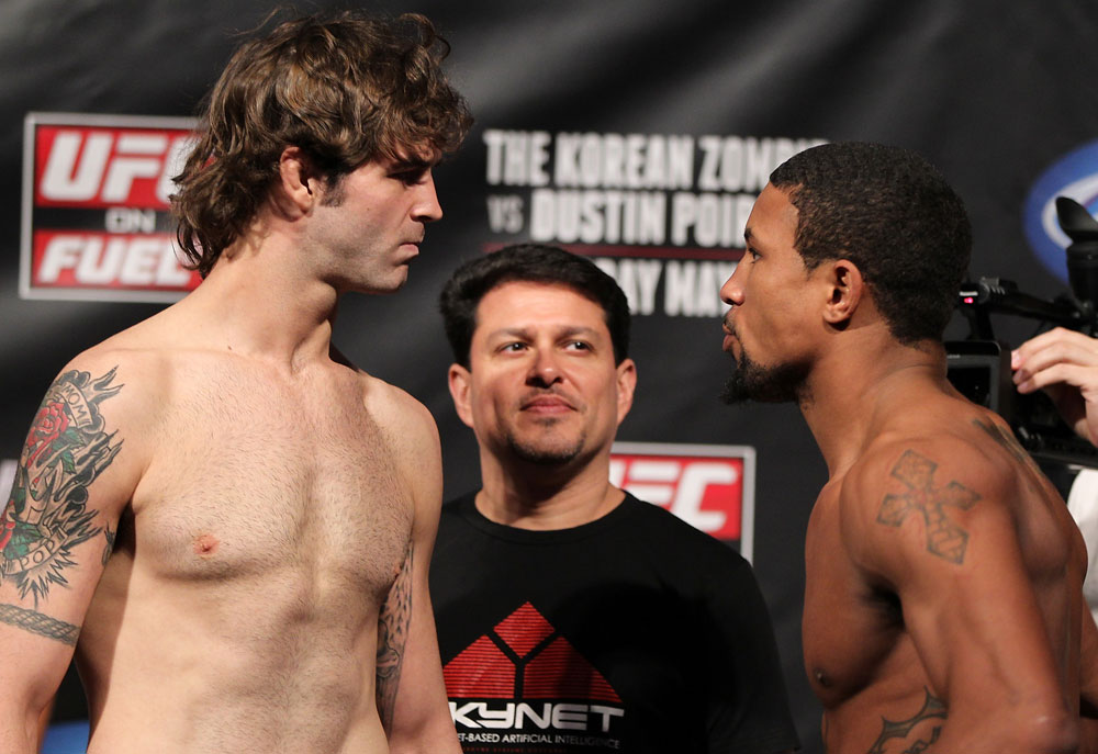 FAIRFAX, VA - MAY 14:  (L-R) Lightweight opponents Cody McKenzie and Marcus LeVesseure face off after weighing during the UFC on Fuel TV official weigh in at Patriot Center on May 14, 2012 in Fairfax, Virginia.  (Photo by Josh Hedges/Zuffa LLC/Zuffa LLC via Getty Images)