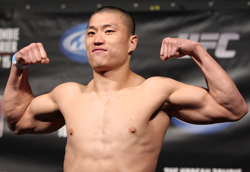 FAIRFAX, VA - MAY 14:  Dongi Yang makes weight during the UFC on Fuel TV official weigh in at Patriot Center on May 14, 2012 in Fairfax, Virginia.  (Photo by Josh Hedges/Zuffa LLC/Zuffa LLC via Getty Images)