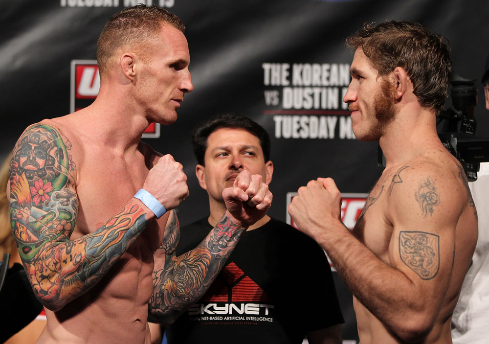FAIRFAX, VA - MAY 14:  (L-R) Middleweight opponents Jason MacDonald and Tom Lawlor face off after weighing in during the UFC on Fuel TV official weigh in at Patriot Center on May 14, 2012 in Fairfax, Virginia.  (Photo by Josh Hedges/Zuffa LLC/Zuffa LLC via Getty Images)