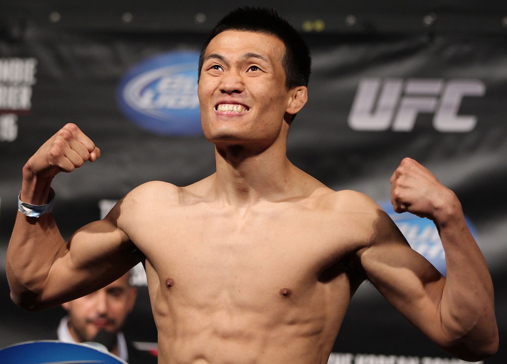 "FAIRFAX, VA - MAY 14:  ""The Korean Zombie"" Chan Sung Jung makes weight during the UFC on Fuel TV official weigh in at Patriot Center on May 14, 2012 in Fairfax, Virginia.  (Photo by Josh Hedges/Zuffa LLC/Zuffa LLC via Getty Images)"