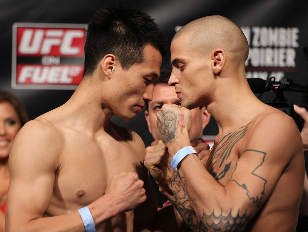 FAIRFAX, VA - MAY 14:  (L-R) Featherweight opponents &quot;The Korean Zombie&quot; Chan Sung Jung and Dustin Poirier face off after weighing in during the UFC on Fuel TV official weigh in at Patriot Center on May 14, 2012 in Fairfax, Virginia.  (Photo by Josh Hedges/Zuffa LLC/Zuffa LLC via Getty Images)