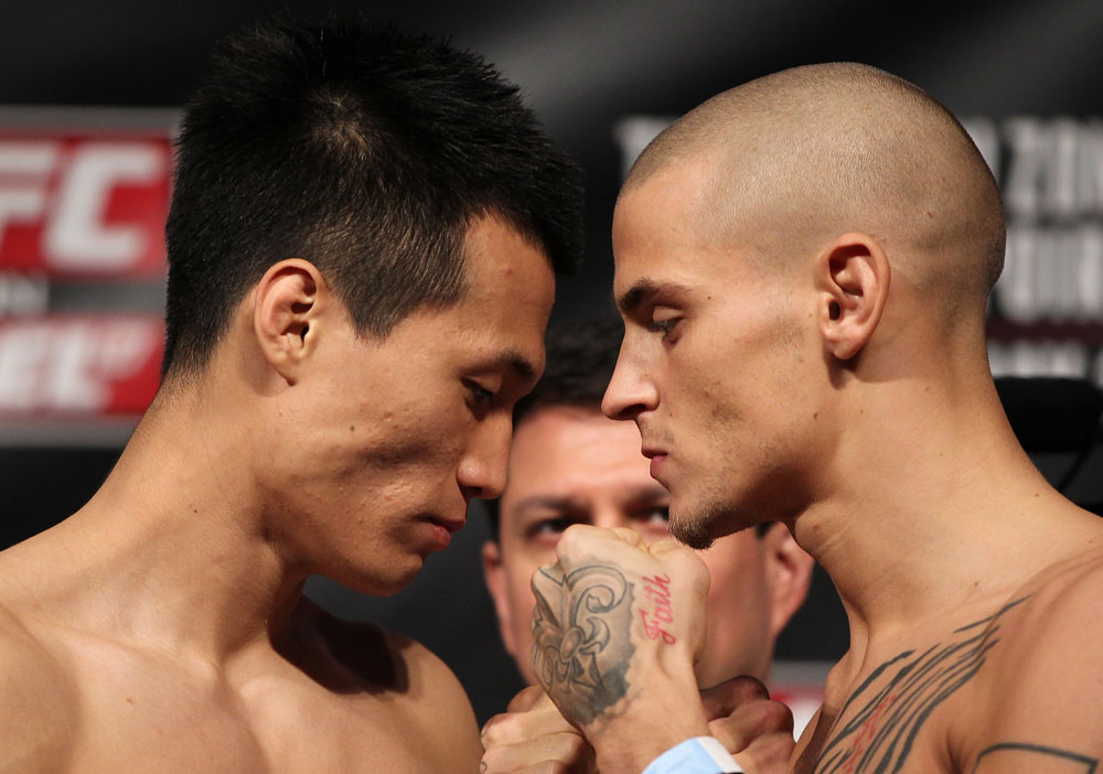 "FAIRFAX, VA - MAY 14:  (L-R) Featherweight opponents ""The Korean Zombie"" Chan Sung Jung and Dustin Poirier face off after weighing in during the UFC on Fuel TV official weigh in at Patriot Center on May 14, 2012 in Fairfax, Virginia.  (Photo by Josh Hedges/Zuffa LLC/Zuffa LLC via Getty Images)"