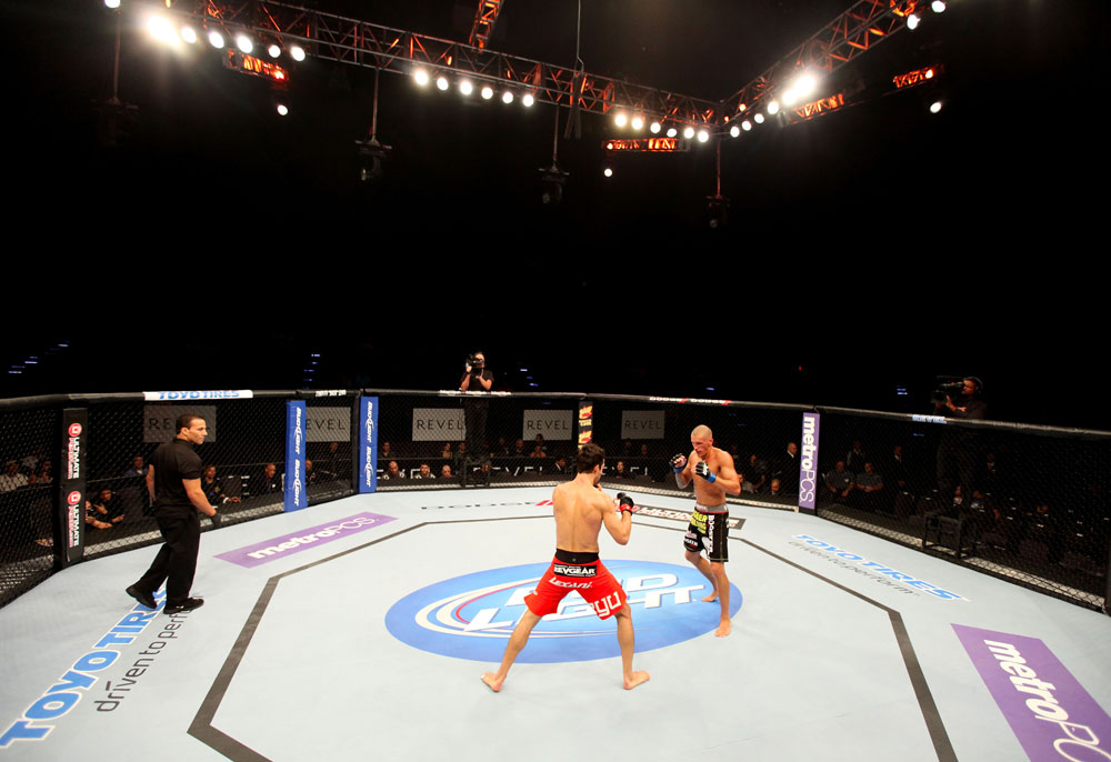 ATLANTIC CITY, NJ - JUNE 22:  Ken Stone (C) circles the octgagon with Ricardo Funch (R) as referee Gasper Oliver (L) looks on in a bantamweight bout during UFC on FX 4 at Revel Casino on June 22, 2012 in Atlantic City, New Jersey.  (Photo by Nick Laham/Zuffa LLC/Zuffa LLC)